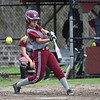 Aleysha Santos of Fitchburg chops at the ball during Monday's varsity softball match up between Fitchburg and North Middlesex at Fitchburg High School.  SENTINEL & ENTERPRISE JEFF PORTER