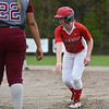 Maggie Hacker of North Middlesex leads off first as the pitch is thrown during Monday's varsity softball match up between Fitchburg and North Middlesex at Fitchburg High School.  SUN/JEFF PORTER