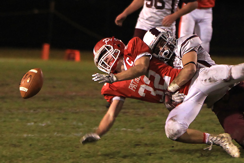 North Middlesex's Jake Hachey loses the ball as he is hit by a Northbridge player during a game in Townsend on Thursday, Nov. 10, 2016. SENTINEL & ENTERPRISE / SCOTT LAPRADE
