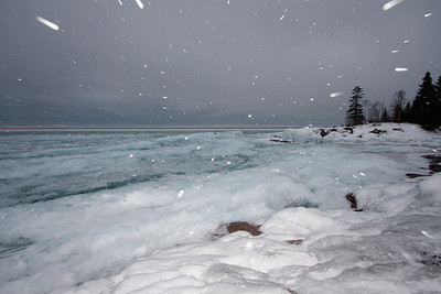 The beginning of a snowstorm at sunrise overlooking Lake superior in Temperance River State Park.