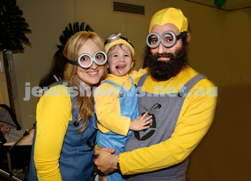 North Shore Chabad Purim In the jungle party. Keren and Eli Gescheit with their son Mendel, dressed as Minions. Pic Noel Kessel.