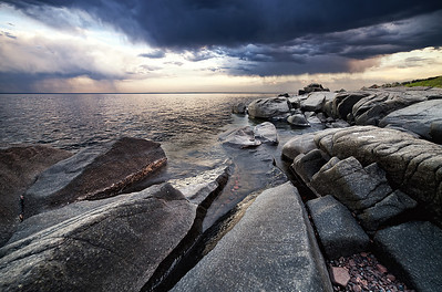 A spring thunderstorm soaks the Lake Superior shoreline for miles around Brighton Beach.