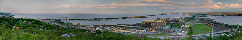 The City of Duluth, Minnesota as viewed from the Gazebo overlooking the town in Enger Tower park.  The sun was setting and golden spots of light were barely peeking through to touch the tree tops on Park Point and Superior, Wisconsin.