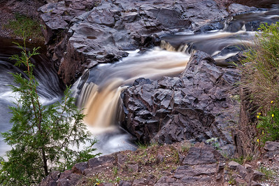 The Lester River drops from a small set of waterfalls into a small pool not far from the Lake Superior shoreline.