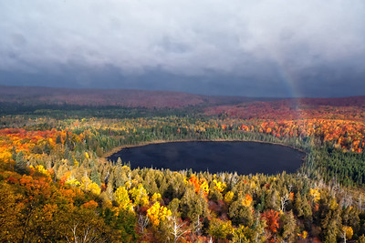 A rainbow shoots up from the blanket of North Shore fall color below Oberg Mountain as viewed at the end of September 2011.