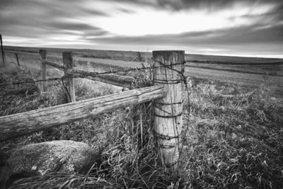 A rugged fence stands watch over this prairie sunset in South Dakota.