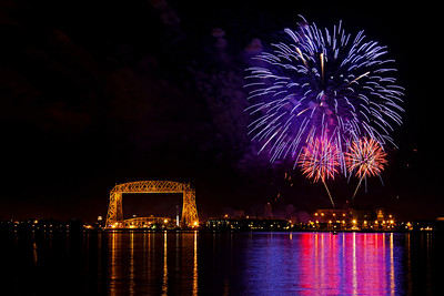 The 2011 Fourth of July fireworks display viewed over Lake Superior from the shoreline near Leif Erikson park.  3/3