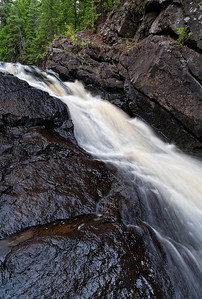 The French River Falls carve their way through the stone walls surrounding this North Shore waterfall.  1/4