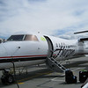 Did I say a jet was waiting to take us home?  Oh, silly me!  A prop-job awaits to take us to SeaTac.  We actually have to walk out onto the tarmac, and our carry-ons are loaded into the belly of the plane.  I'm guessing our checked luggage was flying behind us on a trailing sky-sled.