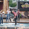 """a nice bit of log-rolling<br /> <br /> I don't know the name of the fella in the hardhat, but the roller on the right is Curt Karboski.  His bio in the little show phamplet says his 6-foot arm span gives him a powerful axe swing and that during his summer stay in Alaska, """"he hopes to wrestle a salmon, swim with the otters and catch lots of crabs""""......."""