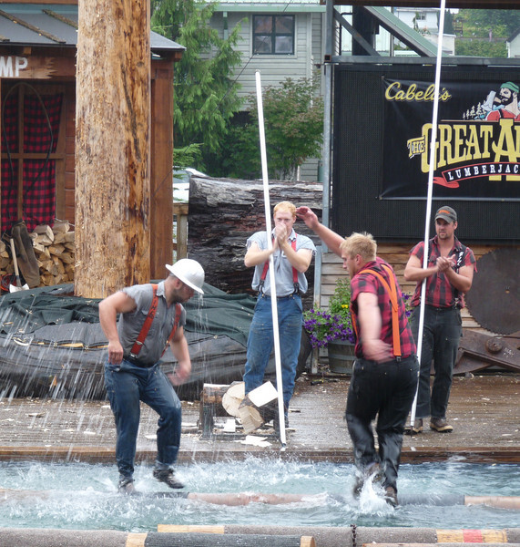 see the water raining down on Hard Hat from Curt's splashy kicks<br /> <br /> Those long poles the boys in the background are holding are to help the rollers get on the logs when they first start out.