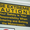 """Dorothy, you're not in Kansas anymore"" -- as evidenced by this sign in the public bus.  My safety is MY responsibility?  What gives?!?  Why, that's un-American!  Ya, Pilgrim, that's Canadian!"