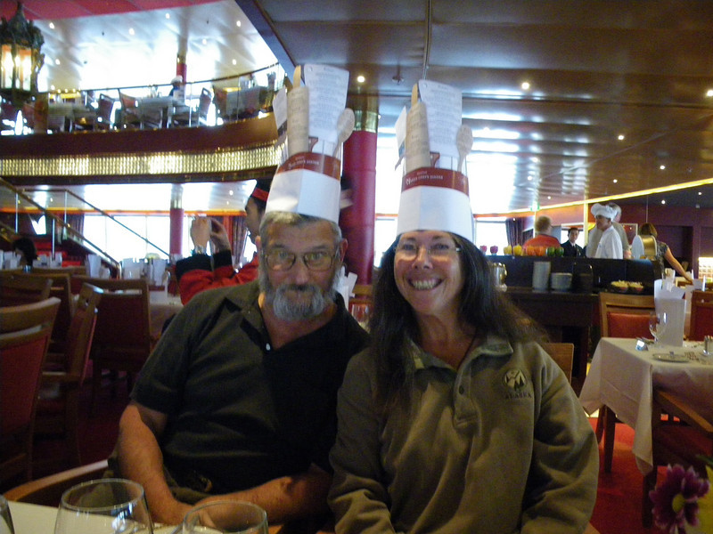 Dinner on the ship our last night was a festive affair, indeed -- as evidenced by these two hardy partiers.  Yes, the chef hats were distributed to all guests that night (it had the menu written on it!).