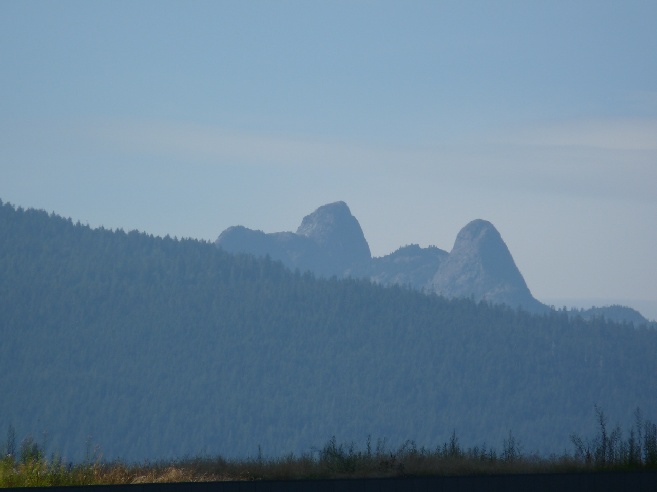"Zoomed in, you can see those are the ""Two Sisters Mountains"" (or, ""Lions of Vancouver"" if you're British).  The Squamish People know the twin peaks as ""The Chief's Daughters"".<br /> <br /> The legend is a long one, but if you are interested in Indian lore and want to read it, link through to:  <a href=""http://www.robirda.com/legends/twosis.html"">http://www.robirda.com/legends/twosis.html</a>"