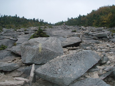 Then there is a long section of rough rock slabs to ascend, with increasing views behind us.