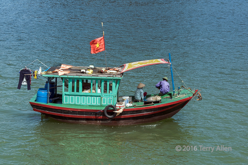Couple fishing in Ha Long Bay, north Vietnam