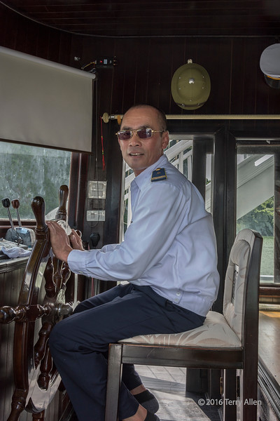 A portrait of our ship's captain on the tour ship in Ha Long Bay, the popular UNESCO World Heritage Site with many limestone karst islands in northern Vietnam.