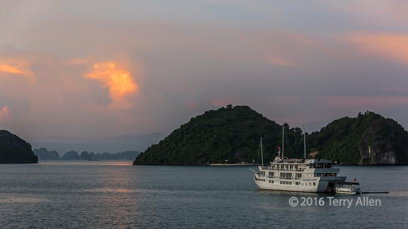 Cruise ship 'Paradise Luxury' at sunset in Ha Long Bay, north Vietnam