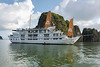 Cruise ship in Ha Long Bay with reflections, north Vietnam