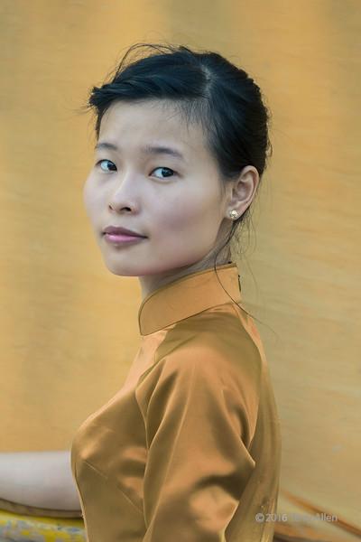 Portrait of a Vietnamese woman against a boat sail, Ha Long Bay, north Vietnam
