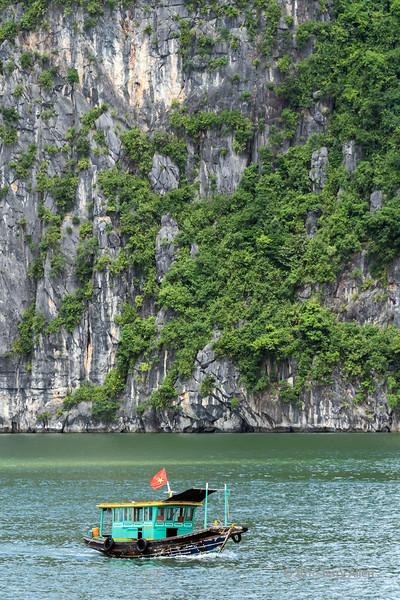 Dwarfed by the cliffs