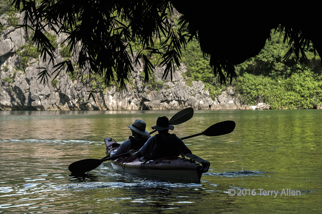 Paddling from the dark to the light, Luon Cave, Ha Long Bay, Vietnam