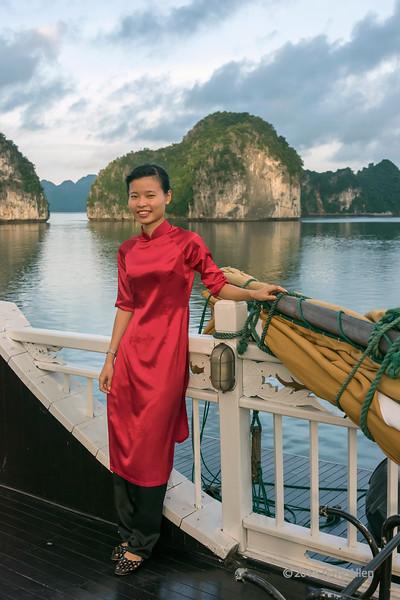 Ha Long Bay islands with woman on junk, north Vietnam