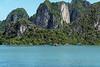 Fishing village and limesstone cliffs, Ha Long Bay, north Vietnam