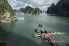 Tourist and tour boats outside the entrance to Sung Sot Cave (Cave of Surprises), Ha Long Bay, north Vietnam