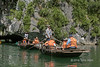 Tourist boats exiting Luon (tunnel) cave in Ha Long Bay, north Vietnam