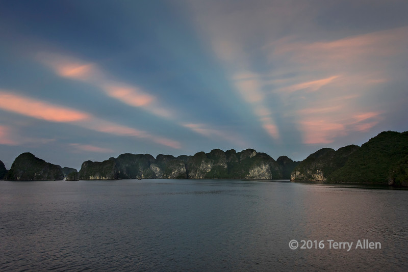 Rays of the setting sun shining through the islands, Ha Long Bay, north Vietnam