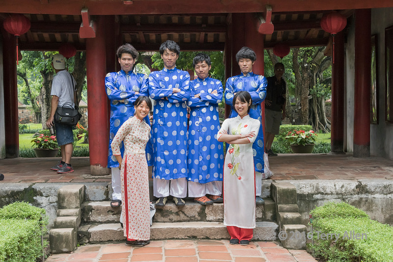 Tourists dressed up to pose in a courtyard at the Temple of Confucious, Hanoi, Vietnam