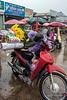 Tying flowers on motor bike, Quang Ba flower market, Hanoi, Vietnam