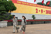 Male and female custodians wallking past the Ho Chi Minh Mausoleum, Hanoi, North Vietnam