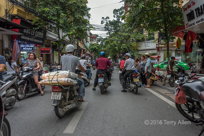 Evening street scene with motorcyles, Hanoi, Vietnam