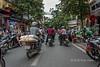 Evening street scene with motorcyles, Hanoi, Vietnam