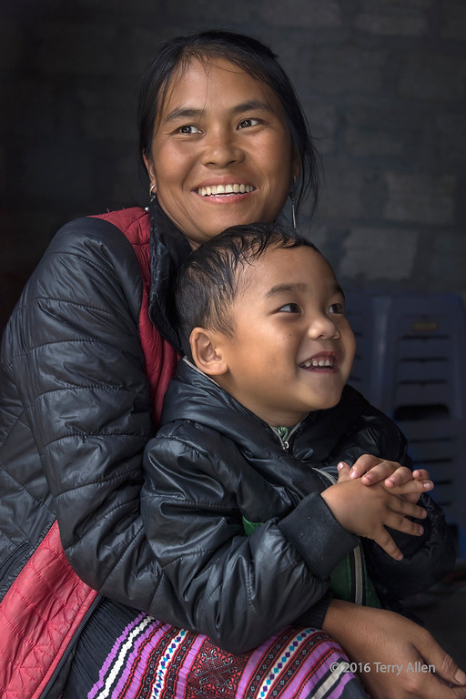 Mother and child in a doorway, Sa Pa, north Vietnam