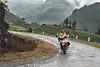 Woman driving a motorcycle on a rainy day, Hoi Lung Sun, north Vietnam