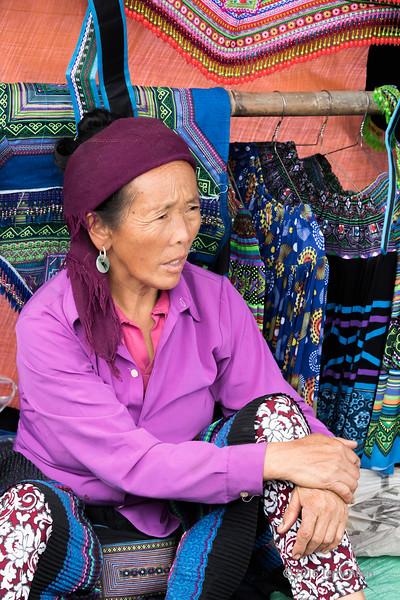 Woman selling traditional clothing, Cuy Ly market, Sa Pa, north Vietnam