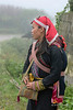 Red Dao woman with baby on back, Sa Pa, Vietnam
