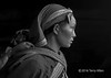 Young Red Dao woman with baby on back lit by a doorway BW, Sa Pa, Vietnam