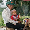 Roadside shopkeeper and his son, Lao Cai to Sa Pa road, Vietnam