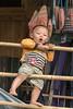 Boy playing on bamboo poles, Ta Van valley, Sa Pa, north Vietnam
