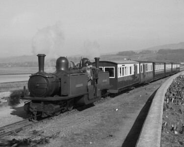I took this shot myself  on the same day in April 1962 with my Zeiss Ikon Nettar.  It shows Merddin Emris approaching Porthmadog Harbour station with the train from Tan y Bwlch.