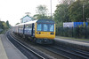 142 039 + 150 204 <br /> <br /> Location: Huyton <br /> <br /> Working 16.31 Lime St - Wigan North Western <br /> <br /> Date: 12th October 2012