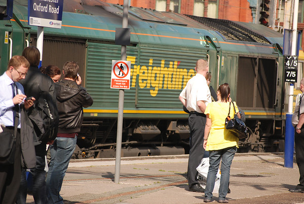 Commuters stare at the Freightliner Logo on 591 as it passes em by
