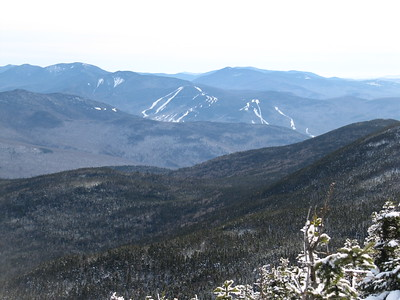 Loon Mtn. and its ski trails with Mt. Shaw in the Ossipee Range in the back