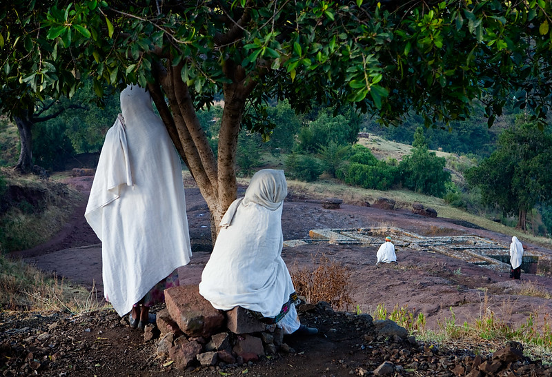 Pilgrims at Bet Giyorgis rock hewn church at dawn - Lalibela