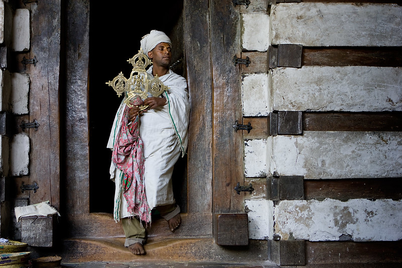 The priest at the Yemrehanna Kristos church - Lalibela