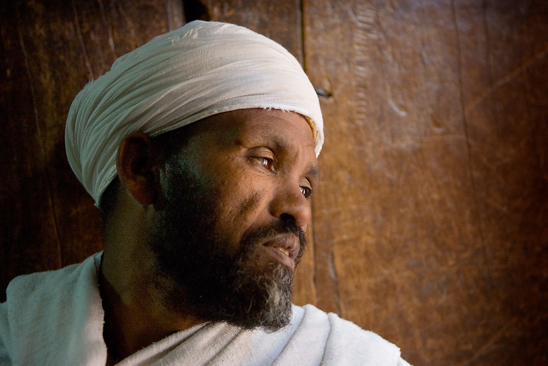 Priest in one of the rock hewn churches of Lalibela